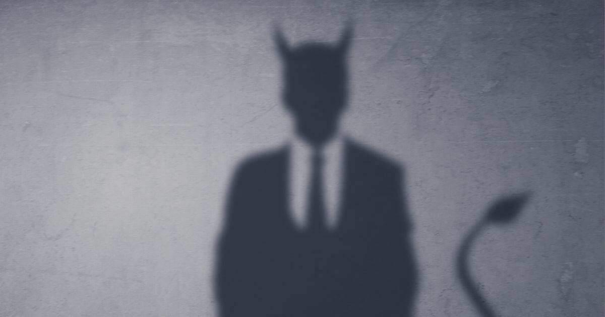 銀行員の悪魔のシルエット