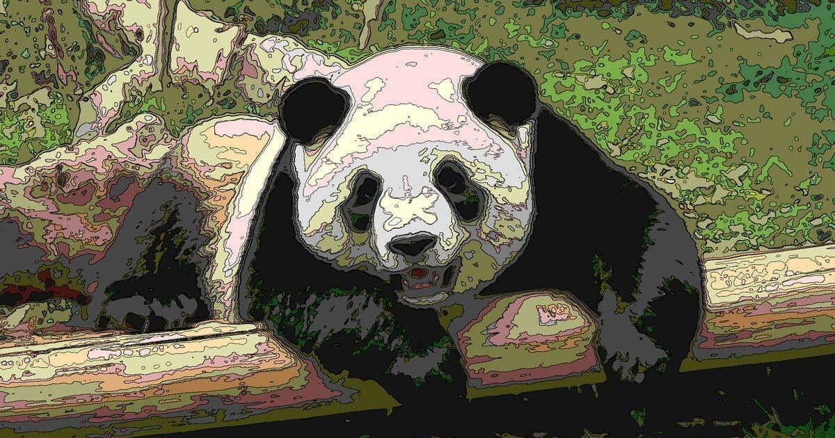 丸太にもたれかかるジャイアントパンダ